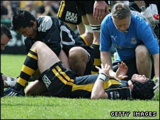 Danny Cipriani is tended by medical staff after suffering the injury