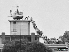 Vietnamese evacuees onto an Air America helicopter, 1975