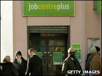 People queuing outside a job centre in London