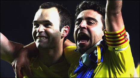 Andres Iniesta (left) and Xavi celebrate at Chelsea