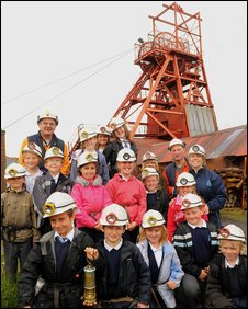 Pictured are Class 3/4 holding commemorative souvenir with Miner Guides, Des Harris and Mike Parfitt