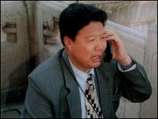 A man speaking on a mobile phone