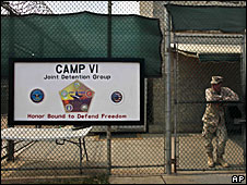 A soldier stands guard at the front gate entrance to Guantanamo Bay's Camp 6 maximum-security detention facility, 12 May 2009