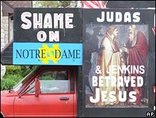 "An activist opposed to Mr Obama's visit to Notre Dame drives a van on which is written: ""Shame on Notre Dame; Judas and Jenkins betrayed Jesus""."