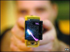 UK police officer demonstrates stun gun