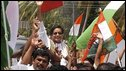 Congress party candidate Shashi Tharoor, centre top, celebrates with supporters in Trivandrum, India, 16 May 2009