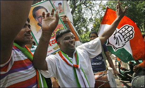 A Congress supporter celebrating the win