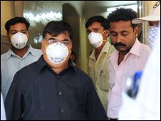 Staff wear protective face masks at Naidu hospital in Pune, India, 11 May 2009