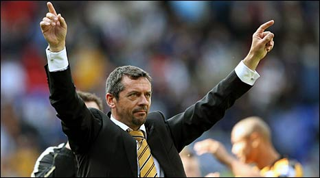 Hull City manager Phil Brown salutes his side's fans at Bolton