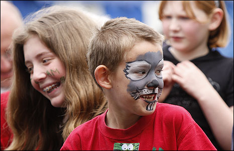Boy with painted face (photo: Claire Borley)