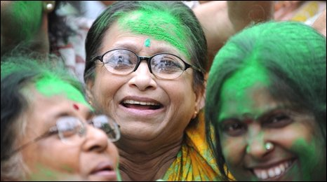 Trinamul Congress supporters with green colouring on their faces to celebrate election results