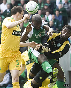 Celtic defender Gary Caldwell challenges Sol Bamba