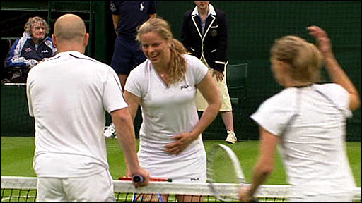 Kim Clijsters reacts to getting hit by Andre Agassi