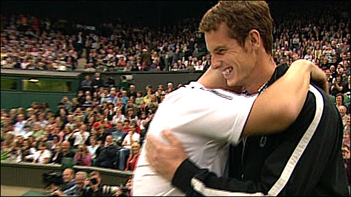 Andy Murray is hugged by Andre Agassi