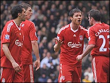 Liverpool defender Jamie Carragher (right) is restrained by Xabi Alonso (second right) after a spat with Alvaro Arbeloa (left)