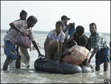 Internally displaced ethnic Tamil civilians cross a lagoon.(image provided by Sri Lanka military on 14 May 2009)