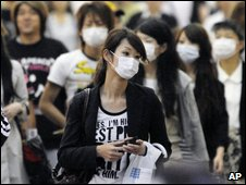 Shoppers wear masks as precaution against swine flu at a shopping street in Kobe, western Japan