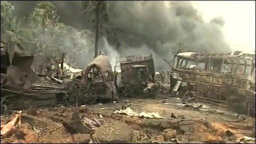 Smoke, burnt out vehicles and debris