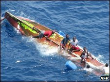 Handout photo from Spanish ministry of defence shows suspected pirates on a capsized boat on 6 May 2009 in the Indian Ocean