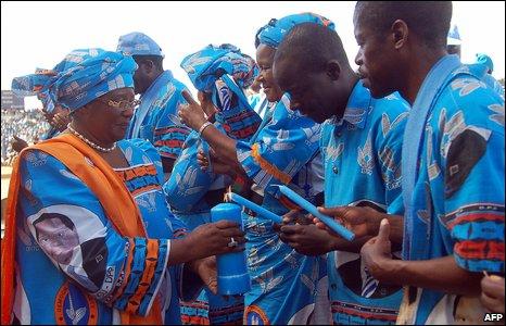 Supporters of incumbent President Bingu wa Mutharika light candles