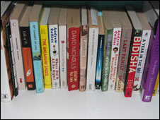 Various book titles on a shelf