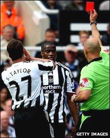Steven Taylor,  Sebastien Bassong and referee Howard Webb