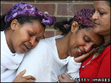 Arsema Dawit's mother is comforted by a friend