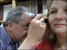 Dr David Baguley examining a patient