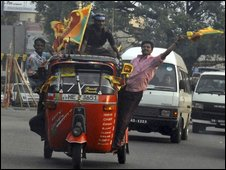 Sri Lankans hold celebrate the defeat of the Tamil Tiger rebels, in Colombo, 18 May 2009.