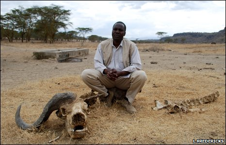 Bernard Kuloba in front of a drinking trough supplied by water from a borehole, Lake Nakuru