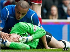 Madjid Bougherra comforts injured goalkeeper Jamie Langfield