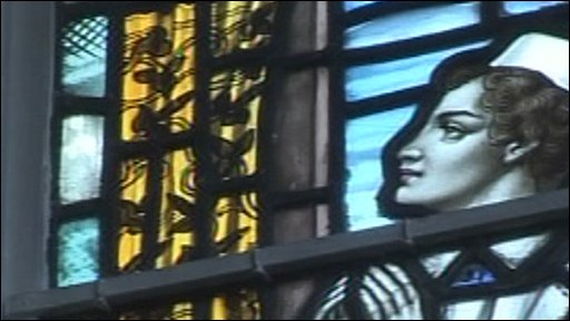 Stained glass image of nurse at DRI