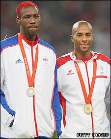 Phillips Idowu and Nelson Evora