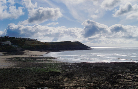 Fluffy clouds float in the skies over the Gower near Swansea (Lee Street).
