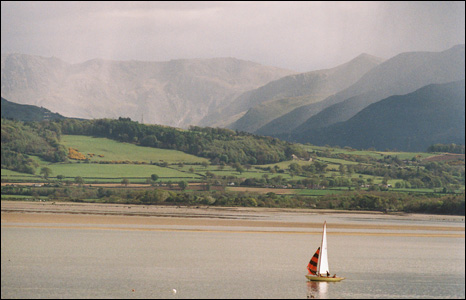 Gareth Whiting from London captures a peaceful-looking Menai Straits with a big storm in Snowdonia in the background.