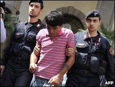 Police escort a suspect in Naples - photo 19 May