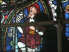 Man working on stained glass window