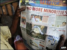 Man reading a newspaper ib Colombo on Wednesday