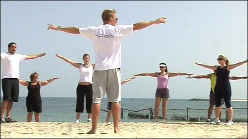 People exercising on the beach