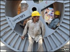 Indian labourers take rest at a roadside work site in Mumbai