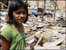 Rubina Ali stands in front of her demolished shanty