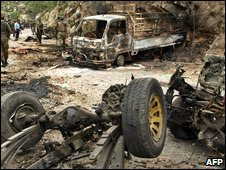 destroyed vehicles in the Buner district