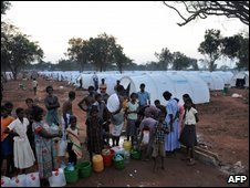 Tamil people wait for water at a camp in the Vavuniya area, 7 May