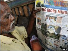 A man reads a newspaper announcing the death of Tamil Tiger leader Prabhakaran in Colombo on May 20, 2009