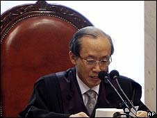 South Korea's Chief Justice Lee Yong-hoon announces the ruling