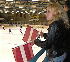 Young woman watching ice hockey game