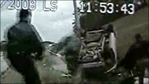 Police video of officers approaching Mr Warren on the roadside