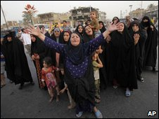 "Women react during the funeral of a victim in Wednesday""s car bomb explosion at Shula in Baghdad, Iraq, Thursday, May 21, 2009"