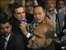 Unidentified relatives of Hisham Talaat Moustafa react to death sentence verdict