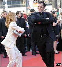 French actress Melanie Laurent and US director Quentin Tarantino dance on the red carpet